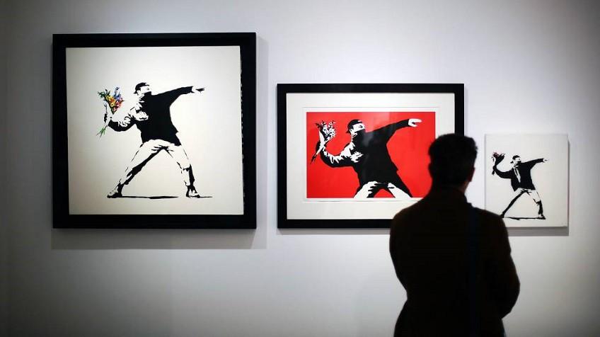 Una obra de Banksy se autodestruye al ser vendida por un millón y medio